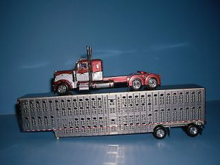 64 COPPER AND GRAY 379 PETERBILT WITH SPREAD AXLE LIVESTOCK TRAILER