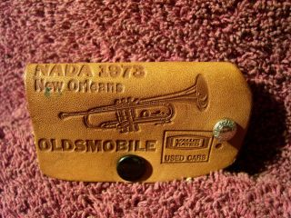 VINTAGE 73 NEW ORLEANS OLDSMOBILE LEATHER KEY FOB HOLDER DEALER AUTO