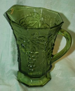 Green Glass Pitcher Embossed Grape Leaf Motif Footed Vintage